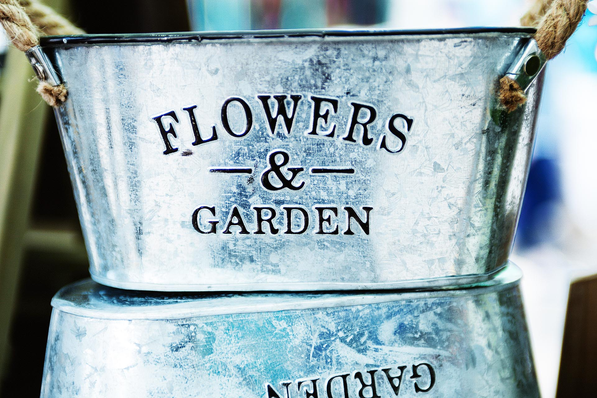 Image of a flowers and garden metallic trug on a table | Amazing garden furniture DIY ideas in collaboration with Sloane and Sons