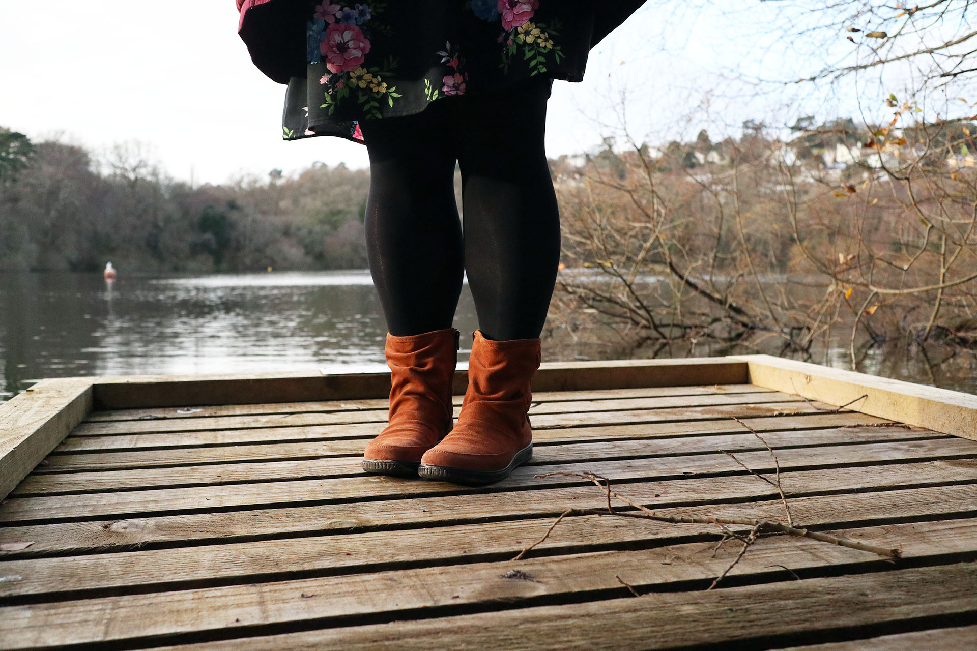 Hotter Shoes Pixie Boots in dark tan, worn by a lake