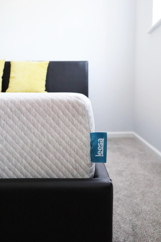 A side view of the Leesa Mattress on a bedframe