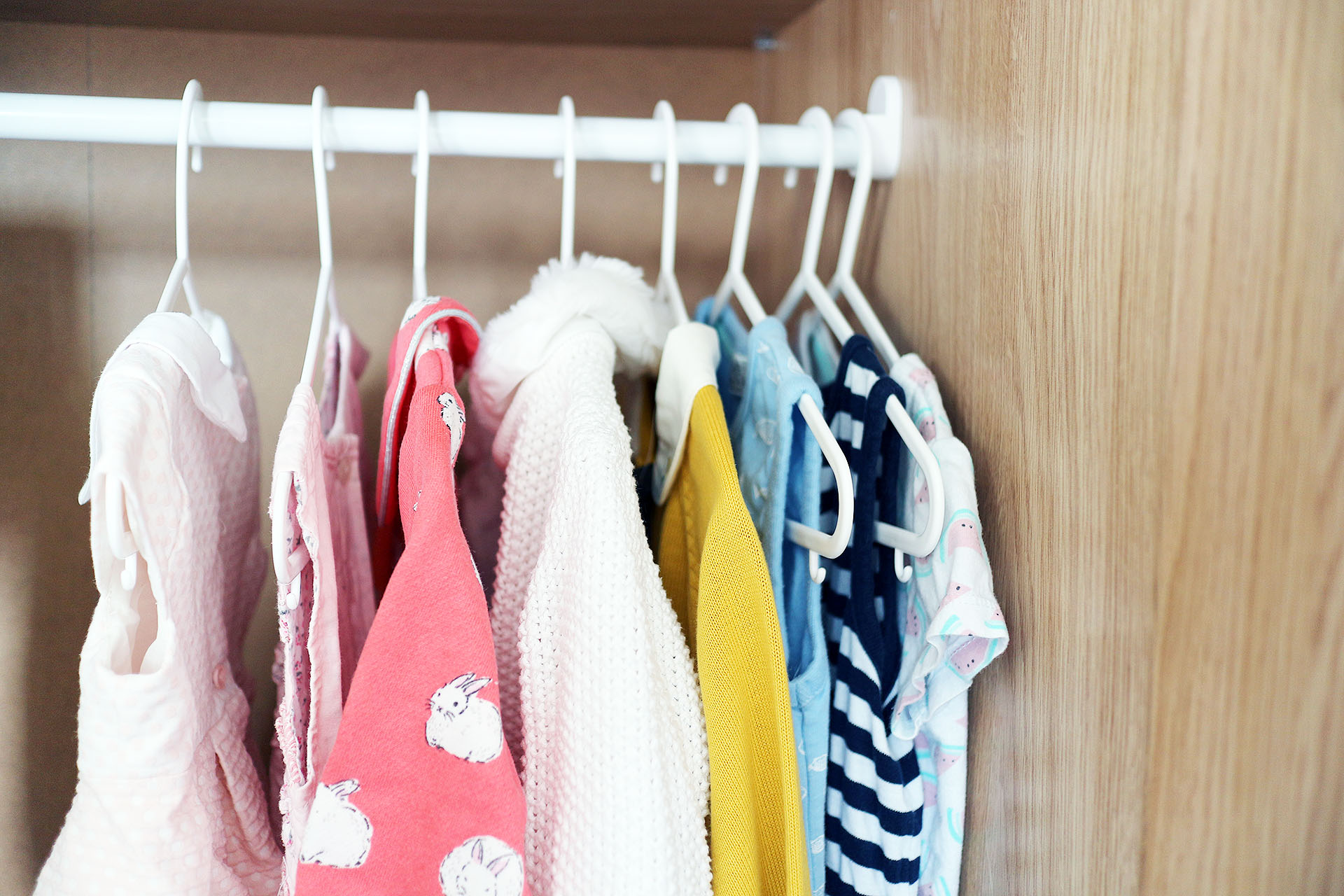 Minimalism + Kids - How to declutter and apply minimalism to your kids' closet or wardrobe. Top tips for decluttering, organising, buying less and donating to charity.