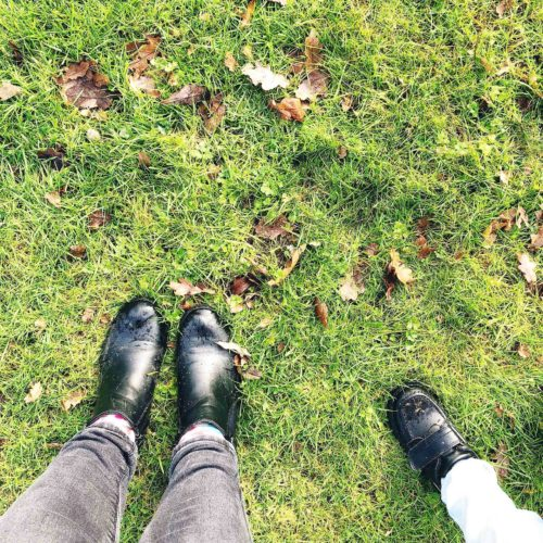 Our feet on grass - emerging from the moving house bubble