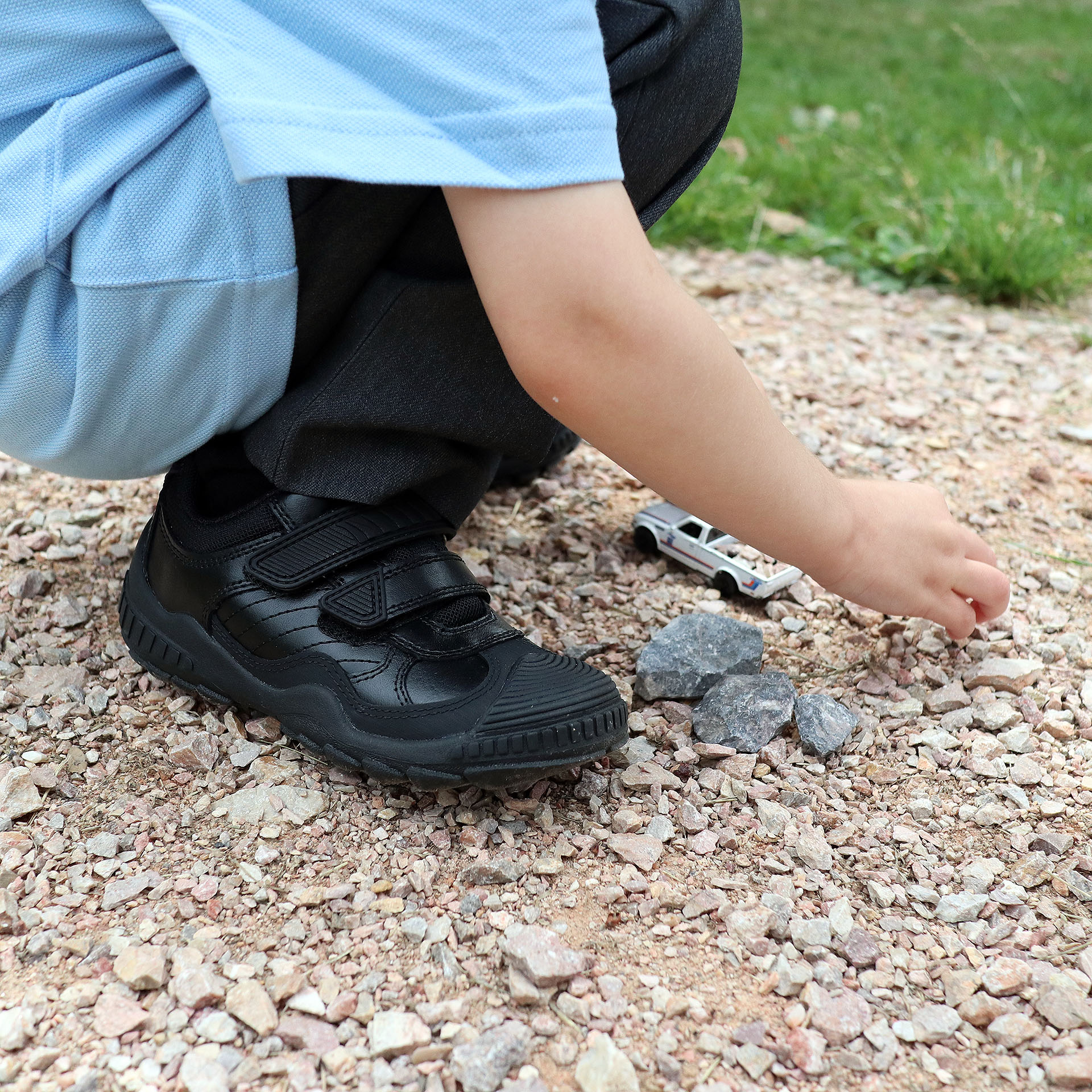 Oscar playing outdoors, wearing his Start-Rite school shoes