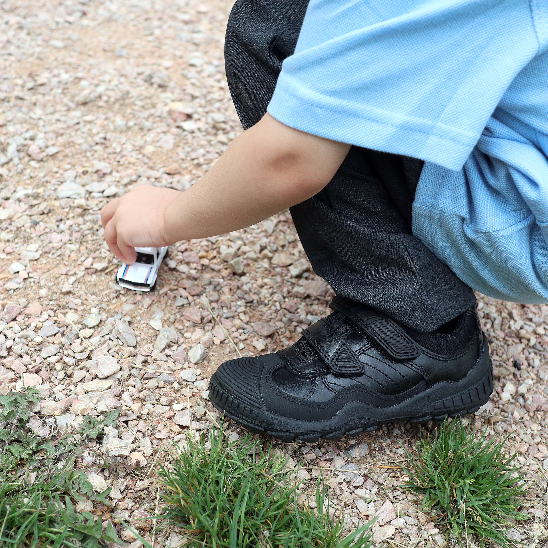 Child playing outdoors in school uniform wearing Start-Rite Extreme school shoes