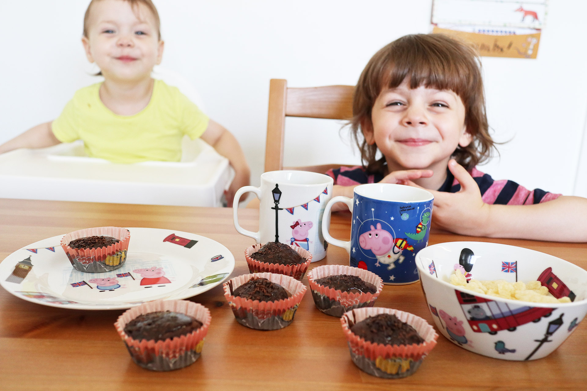 Children smiling after baking chocolate cupcakes
