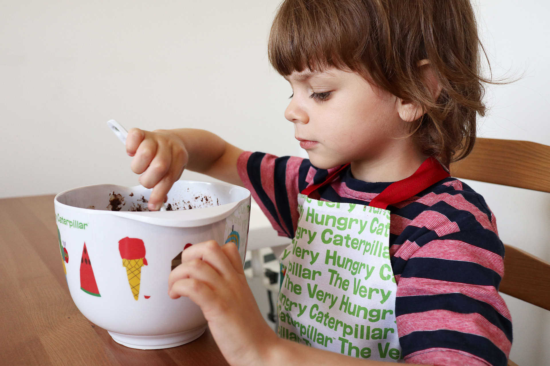 Child baking with a Hungry Caterpillar baking set