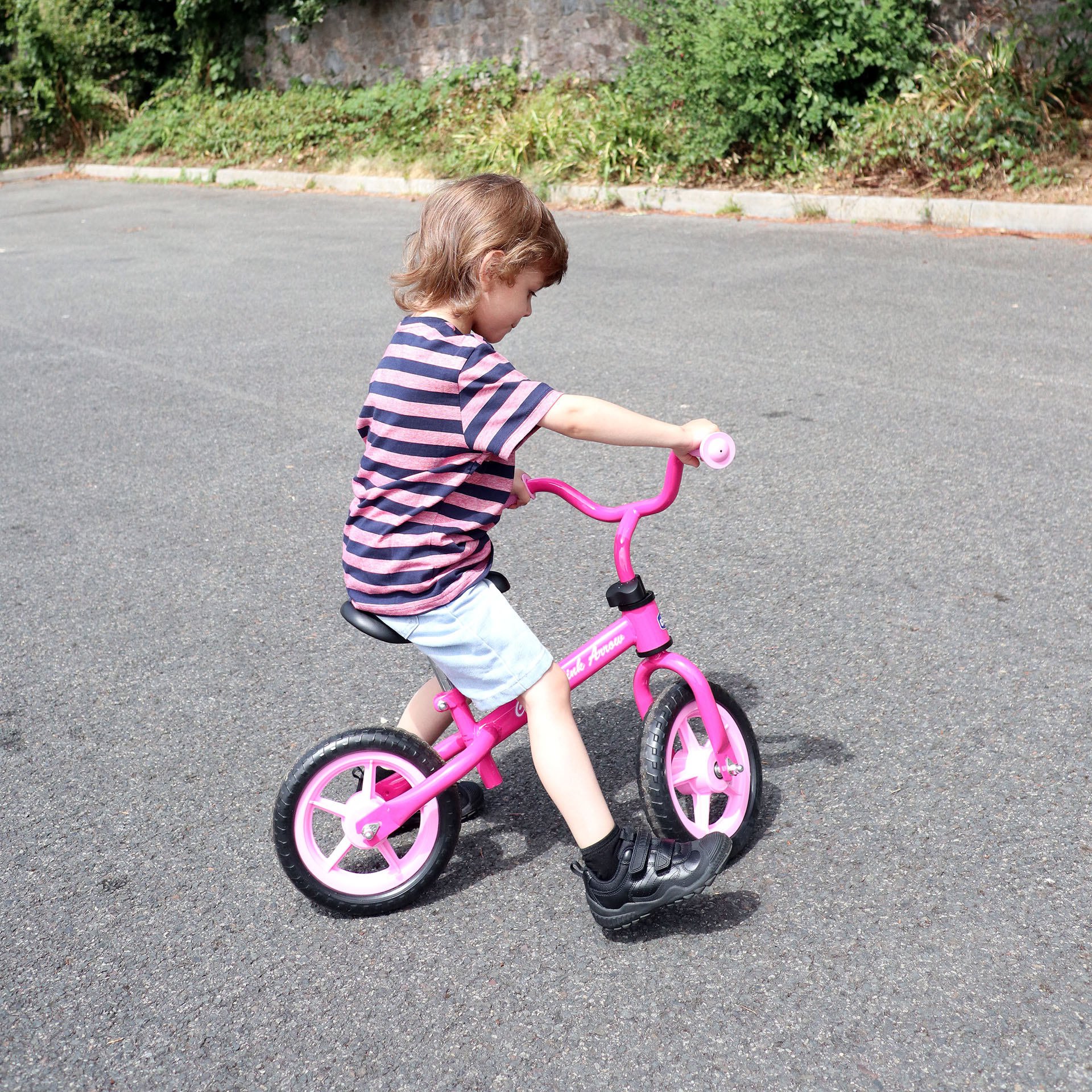 Child riding balance bike wearing Start-Rite Extreme school shoes